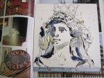 Die fertige Säulenträgerin auf einem Bildband von Hamburg - Foto und Zeichnung von Susanne Haun