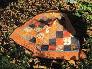 Die warmen Farben des Herbst (c) Quilt von Susanne Bröer